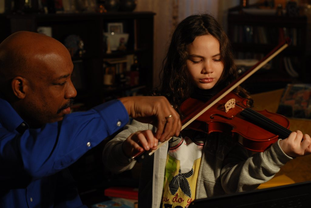 Violin teacher Ashley Horne instructs a student